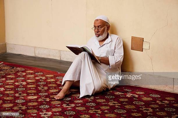 Man Reading The Koran In The Mosque Of AlAqmar Cairo Al Qahirah Egypt