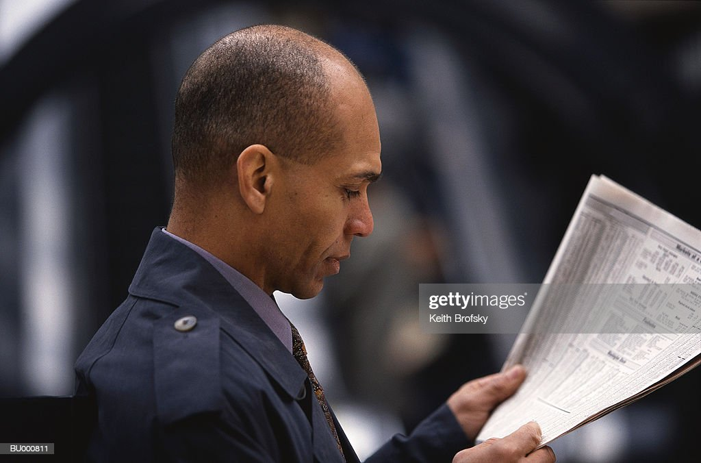 Man Reading the Newspaper Financial Page : Stock Photo