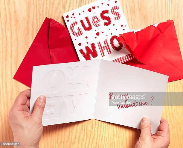 Man reading valentine card