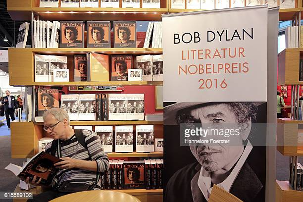 A man reads a book about Bob Dylan at the 2016 Frankfurt Book Fair on October 19 2016 in Frankfurt am Main Germany The 2016 fair which is among the...