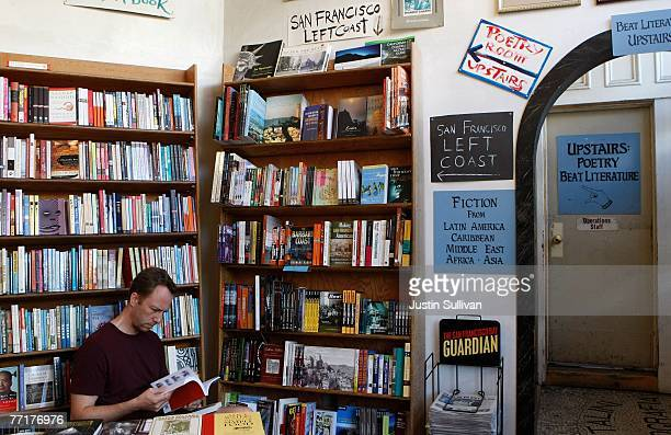 A man reads a book at the City Lights Bookstore October 3 2007 in the North Beach neighborhood of San Francisco California The American Planning...