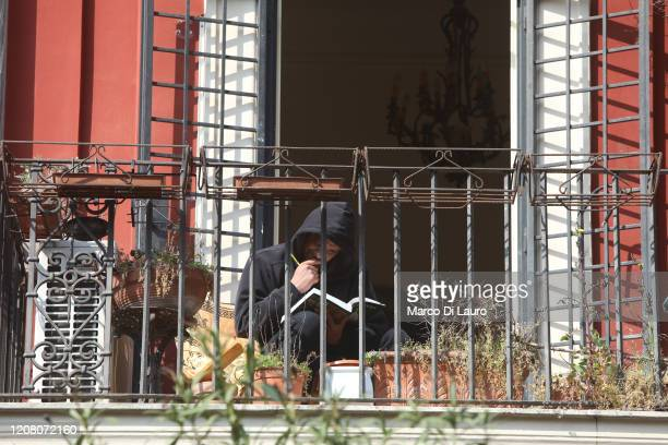 A man reads a book on his balcony on March 22 2020 in Rome Italy As Italy extends its nationwide lockdown to control the spread of COVID19 its...