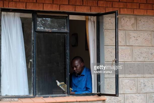 A man reads a book to pass the time at a Government designated quarantine facility in Nairobi on April 04 2020 Hundreds of people held under...