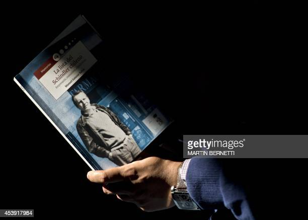 Man reads a book written by Manuel Salazar Salvo, about the life of Jorge Schindler, an activist of the Communist Party of Chile, in Santiago on...