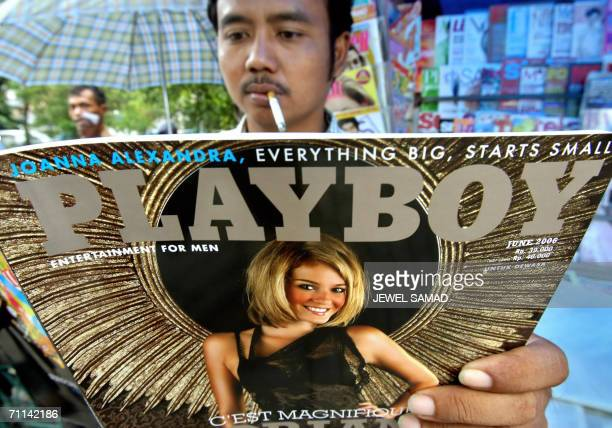 A man reads a copy of the second issue of Indonesian edition of US adult magazine Playboy at a newsstand in downtown Jakarta 07 June 2006 A defiant...