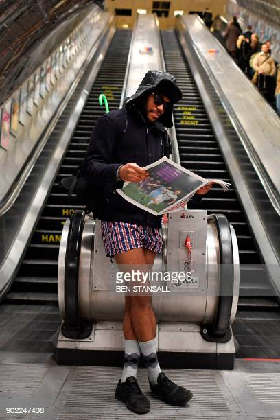 A man reads a newspaper as he takes part in the annual 'No Trousers On The Tube Day' at Liverpool Street Station in London on January 7 2018 Started...