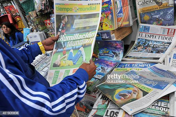 A man reads a newspaper at a newsstand in Bogota on July 9 a day after Germany beat Brazil with a record 71 victory in their FIFA World Cup Brazil...