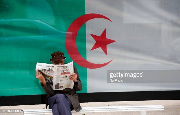 Man reads a newspaper in Algiers, Algeria, on June 7, 2020. Algeria began to resume economic and commercial activities on Sunday as part of easing...