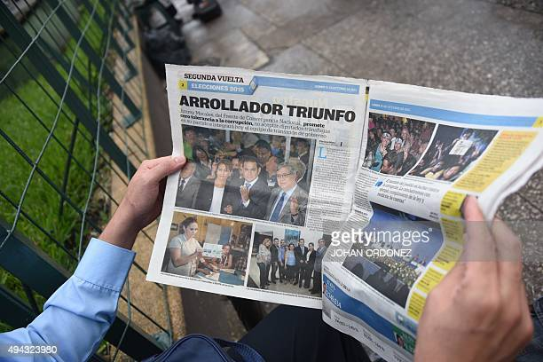 A man reads a newspaper in Guatemala City on October 26 the day after general elections Jimmy Morales a comic actor and TV personality declared...