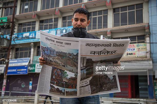 Man reads a newspaper on April 26, 2015 in Kathmandu, Nepal. A major 7.8 earthquake hit Kathmandu mid-day on Saturday, and was followed by multiple...