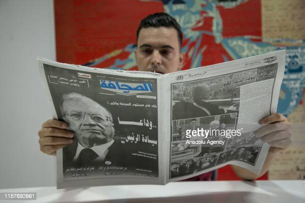 Man reads a newspaper with the death of Tunisian President Beji Caid Essebsi on the headline in the country in Tunis, Tunisia on July 26, 2019.