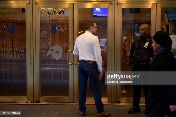 A man reads a notification at the Majestic Theatre that Broadway productions have been suspended on March 12 2020 in New York City As the coronavirus...