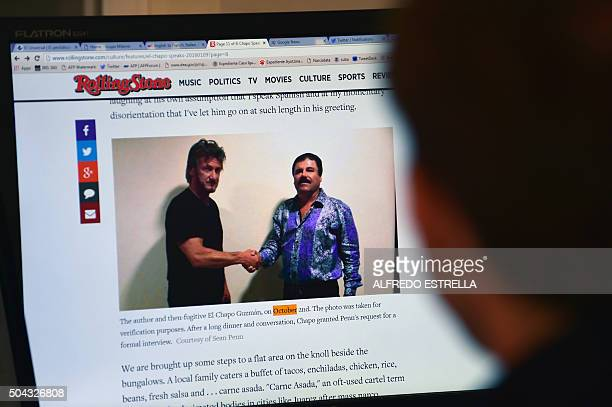 A man reads an article about drug lord Joaquin Guzman aka El Chapo showing a picture of him and US actor Sean Penn on the website of Rolling Stone...
