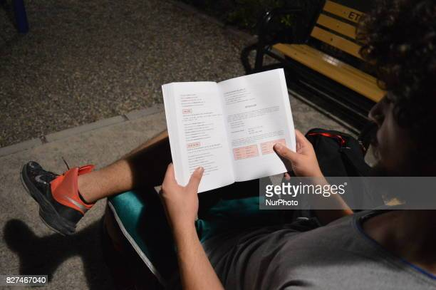 A man reads an educational book in Ankara Turkey on August 07 2017 The Turkish government takes a giant step in Turkey's education system with...
