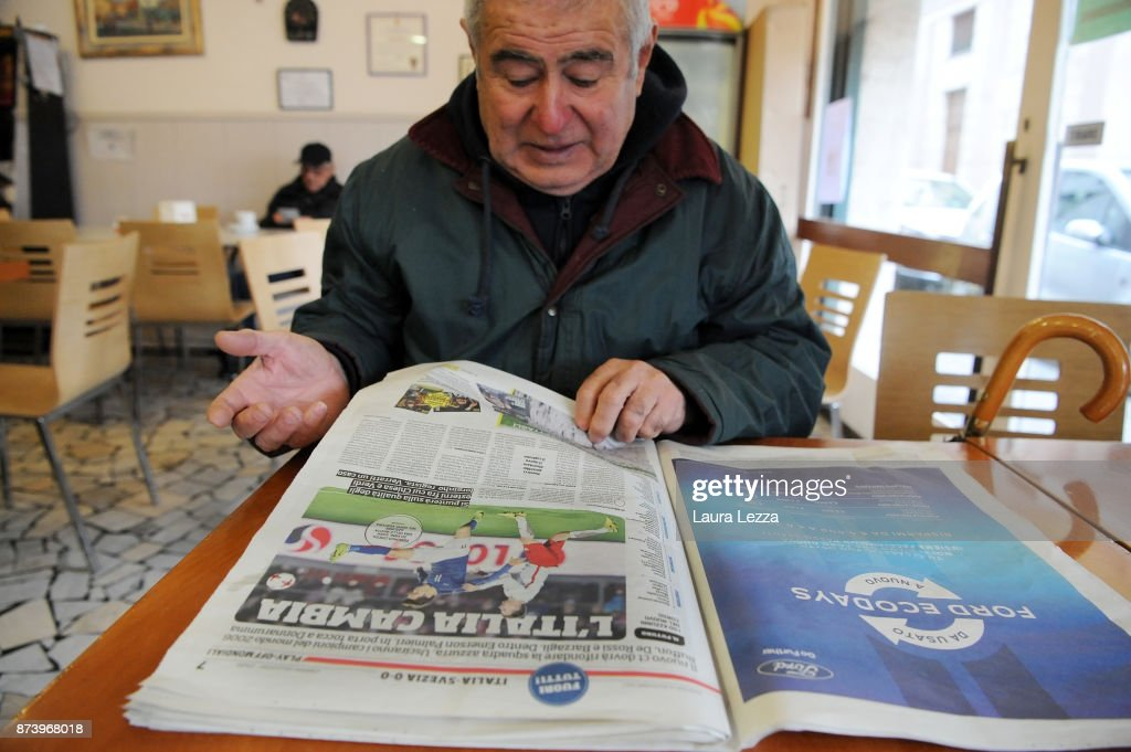 A man reads an Italian newspaper in a bar showing Italy soccer team defeat on their front pages the day after Italy failed to qualify for the World Cup 2018 on November 14, 2017 in Livorno, Italy. For the first time since 1958 Italy will not participate in the next World Cup in Russia, having been beaten by Sweden during the European qualifiers. The captain of the national team and goalkeeper Gianluigi Buffon between the tears came out saying that this defeat is also a social failure for Italy. There are many accusations and demands for resignations in Italy against all vertices of the Federation and the coach.