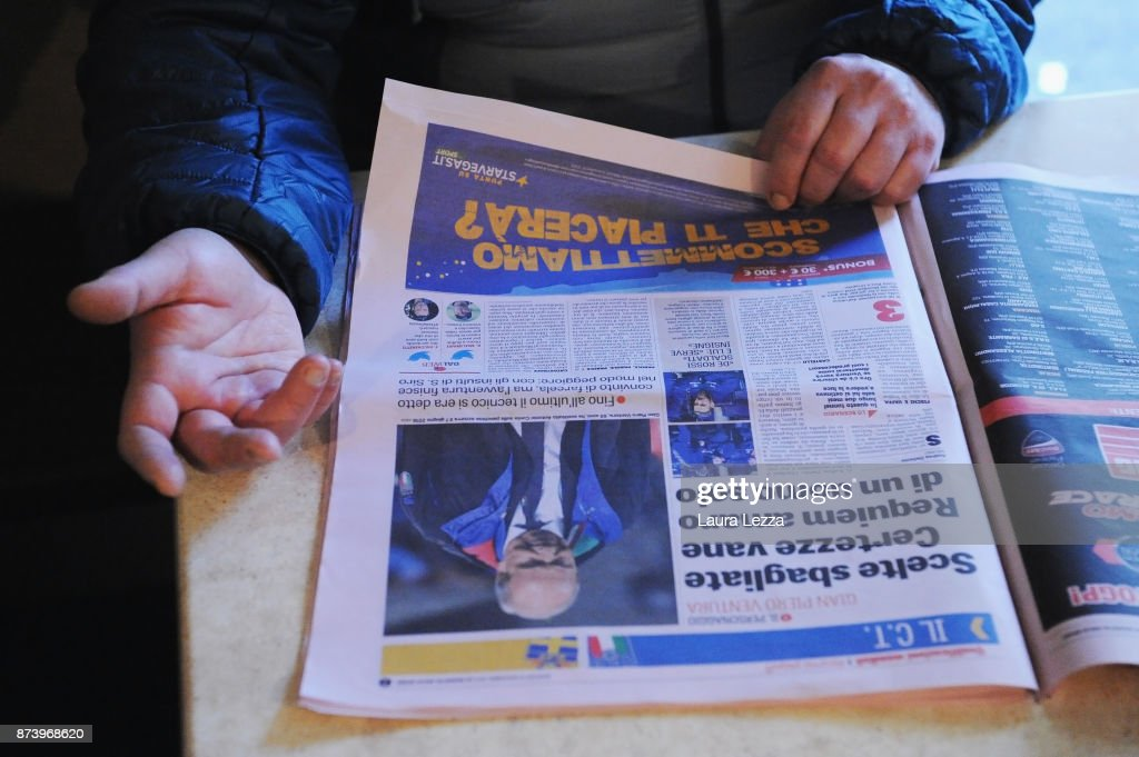 A man reads an Italian newspaper in a bar showing Italy soccer team's defeat on the front pages the day after Italy failed to qualify for the World Cup 2018 on November 14, 2017 in Livorno, Italy. For the first time since 1958 Italy will not participate in the next World Cup in Russia, having been beaten by Sweden during the European qualifiers. The captain of the national team and goalkeeper Gianluigi Buffon between the tears came out saying that this defeat is also a social failure for Italy. There are many accusations and demands for resignations in Italy against all vertices of the Federation and the coach.