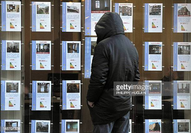 A man reads anouncements of a real estate agent on January 30 2012 in Lille northern France The French construction industry is set to shed 35000...