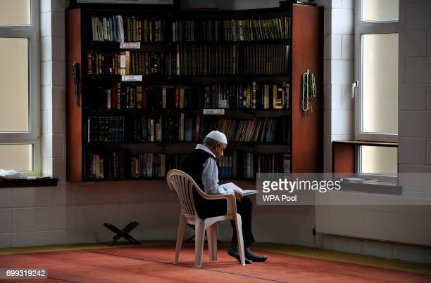 A man reads as Scotland's First Minister and Scottish National Party leader Nicola Sturgeon meets worshippers during a visit to Dundee Central Mosque...