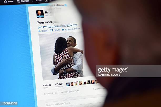 A man reads Barack Obama's tweet on November 7 2012 in Rome after his reelection as US president Barack Obama brought his sophisticated social media...