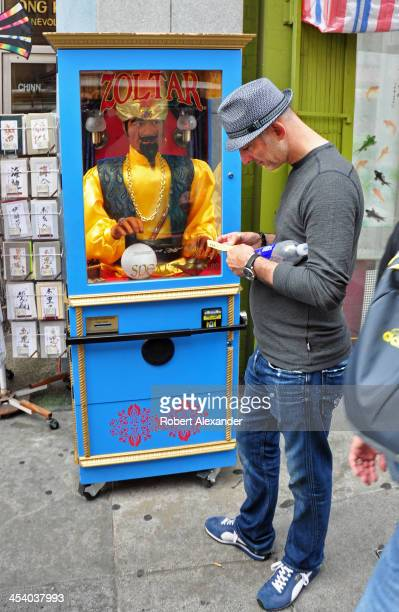 A man reads his fortune after consulting Zoltar a mechanical fortune teller on a sidewalk in San Francisco's Chinatown A Zoltar fortune teller...
