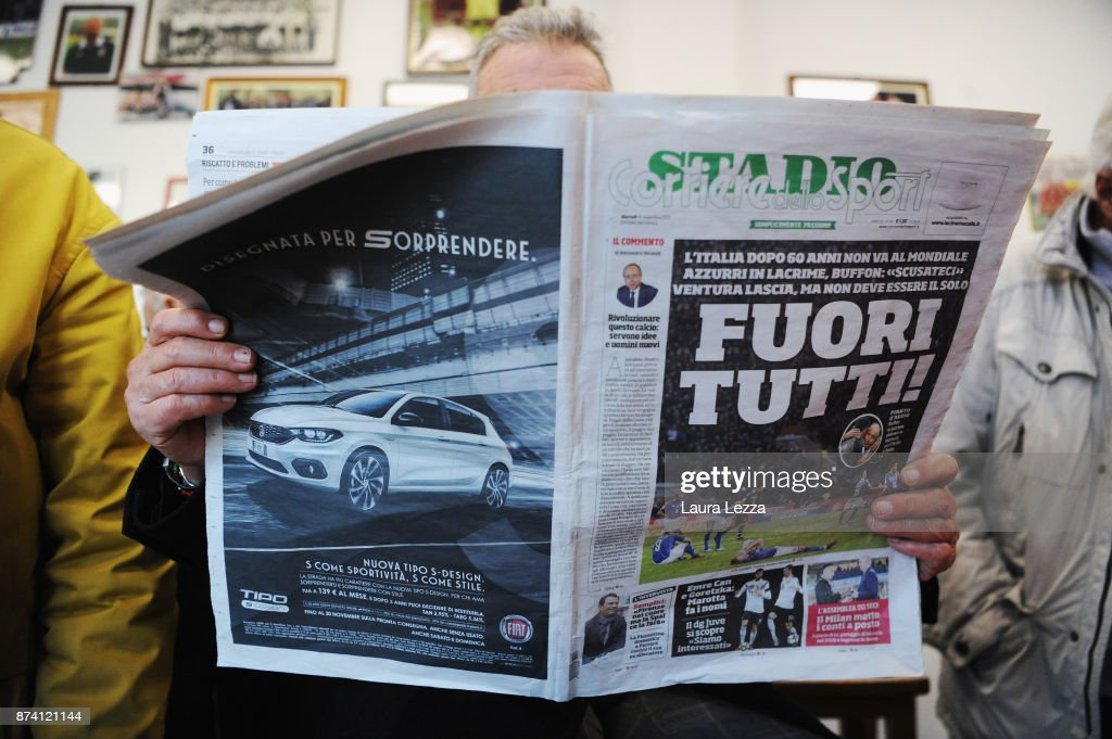 A man reads Italian newspapers in a bar showing Italy soccer team defeat on its front pages the day after Italy failed to qualify for the World Cup 2018 on November 14, 2017 in Livorno, Italy. For the first time since 1958 Italy will not participate in the next World Cup in Russia, having been beaten by Sweden during the European qualifiers. The captain of the national team and goalkeeper Gianluigi Buffon between the tears came out saying that this defeat is also a social failure for Italy. There are many accusations and demands for resignations in Italy against all vertices of the Federation and the coach.