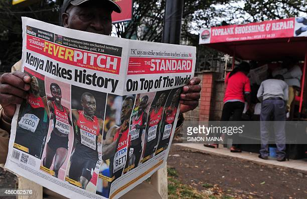 A man reads Kenyan local daily The Standard in Nairobi on August 31 with a headline on the victories of Kenyan athletes at the 2015 IAAF World...