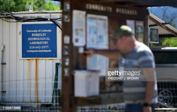 A man reads messages on a community board near the UC Berkeley Seismological Lab for monitoring earthquakes in Parkfield California on July 12 2019...