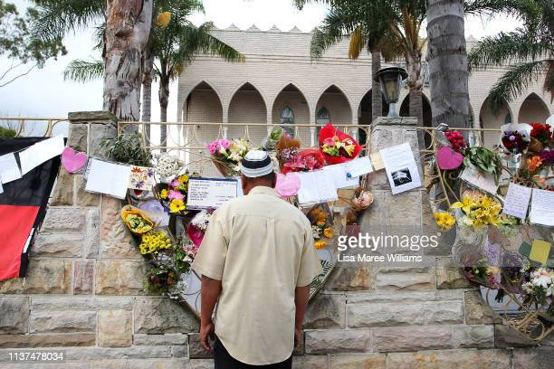 A man reads messages placed on the Lakemba Mosque wall in tribute to the victims of the Christchurch attacks on March 22 2019 in Sydney Australia 50...