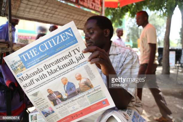 A man reads on March 23 2017 in Arusha northern Tanzania the local Englishwritten daily newspaper 'The Citizen' whose front title refers to the...
