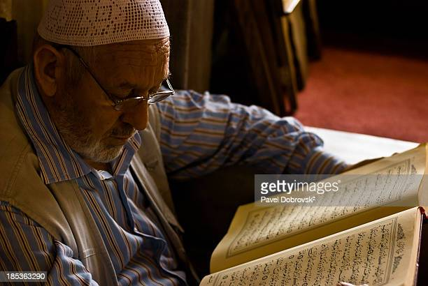 CONTENT] Man reads Quran after the prayer in Eyup mosque Istanbul After prayer it is usual for Muslims to remain in mosque and read Quran