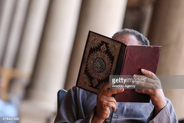 A man reads Quran Islam's holy book at Mosque of Amr ibn alAs on the eighth day of Ramadan in the MisrElKadima neighborhood of Cairo Egypt on June 25...