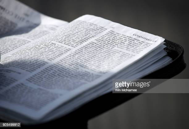 A man reads scripture from the Bible as members of the public wait in line to view the casket of Christian evangelist and Southern Baptist minister...