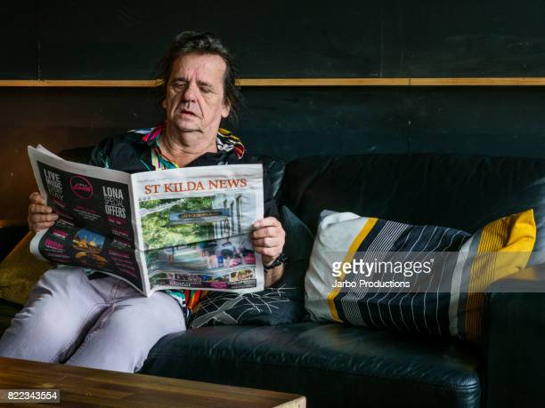 Man reads St Kilda News in Bar
