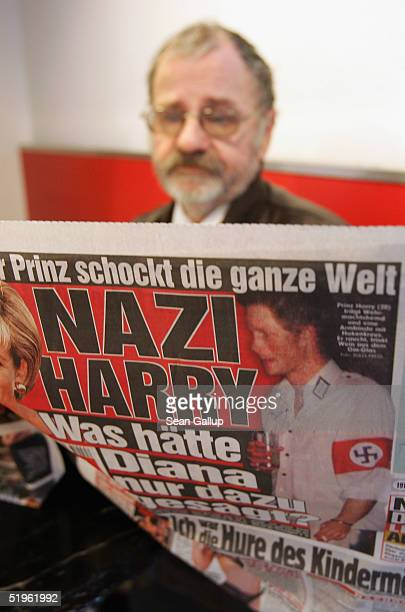 A man reads the day's issue of the German tabloid Bild which features the story of British Prince Harry attending a party dressed in a Nazi uniform...