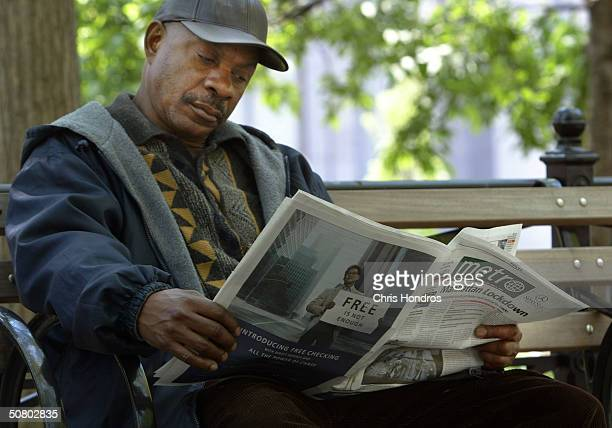A man reads the first edition of the New York edition of Metro newspaper May 5 2004 in New York City Metro a free daily newspaper targeted to 1834...