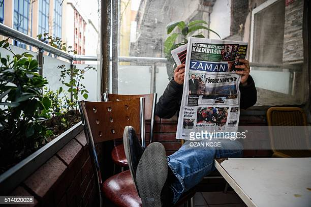A man reads the first new edition of the Turkish daily newspaper Zaman which had staunchly opposed the president now with articles supporting the...
