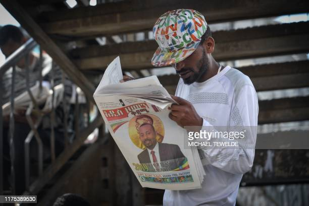 A man reads the last edition of a local newspaper in Addis Ababa on October 12 with the news of Ethiopian Prime Minister Abiy Ahmed's award of The...