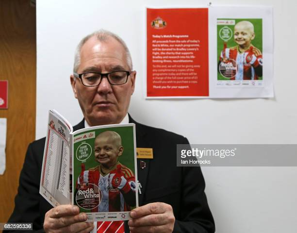 A man reads the match day programme with Bradley Lowery on the front of which the proceeds go to 'Bradley's Fight' during the Premier League match...