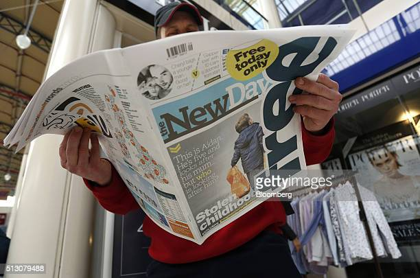 A man reads the newly launched 'The New Day' newspaper produced by Trinity Mirror Plc at Kings Cross railway station in London UK on Monday Feb 29...
