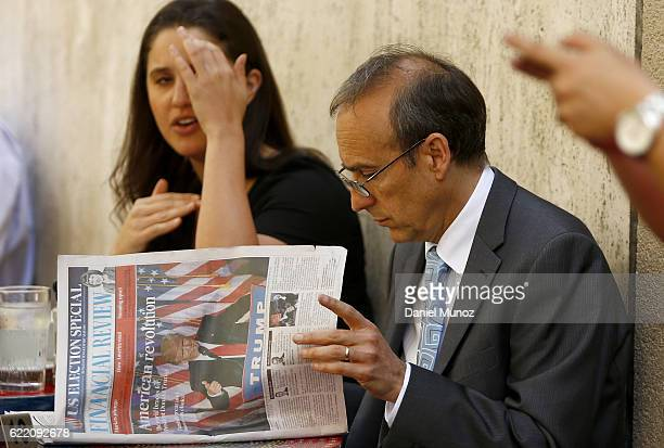 A man reads the newspaper on November 10 2016 in Sydney Australia Americans voted yesterday to elect Donald Trump as the 45th president of the United...