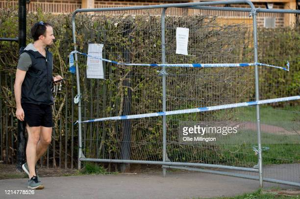 Man reads the sign at a closed outdoor gym at Primrose Hill on March 25, 2020 in London, United Kingdom. British Prime Minister, Boris Johnson,...