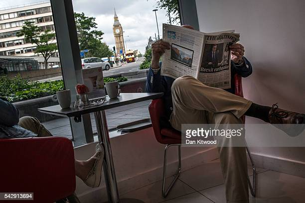Man reads 'The Times' Newspaper in a hotel lobby the day after the majority of the British public voted to leave the European Union on June 25, 2016...