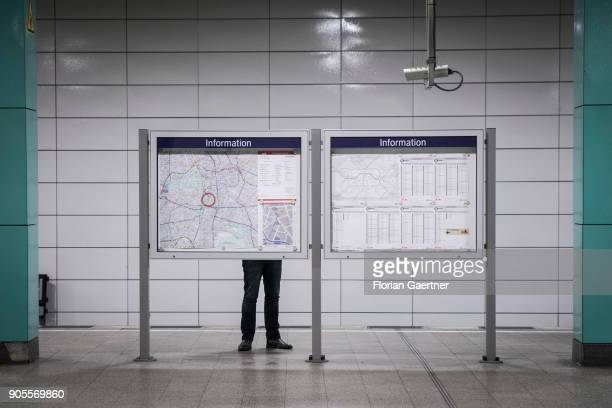 A man reads the timetable of the train station 'Anhalter Bahnhof' on January 15 2018 in Berlin Germany