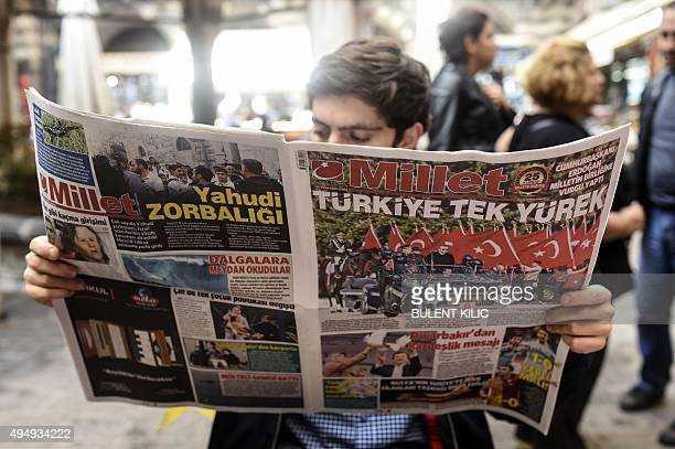 A man reads Turkish daily newspaper Millet in Istanbul on October 30 after the papers Bugun and Millet failed to appear on October 29 a day after...