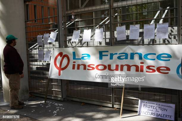 A man reads writings in support of Céline Boussié French whistleblower and president of the association quotHandi'gnezvousquot which she created in...