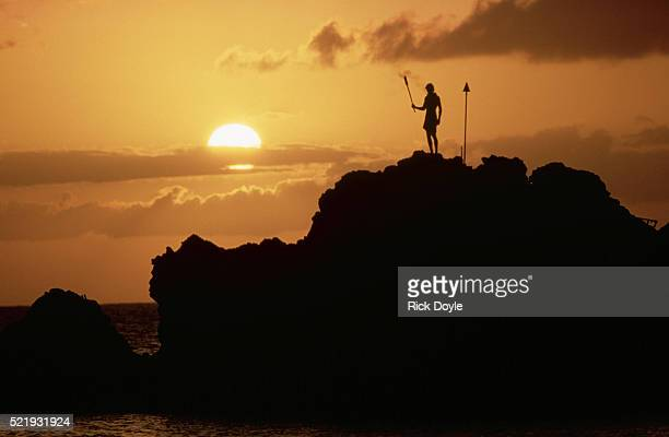 Man Ready to Dive off Point at Sunset