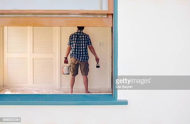 Man Ready to Paint Wall
