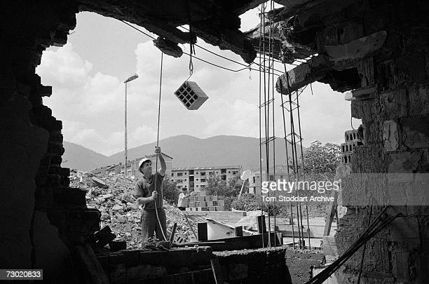 A man rebuilds his war damaged house in Sarajevo after the ceasefire During the 47 months between the spring of 1992 and February 1996 the people of...