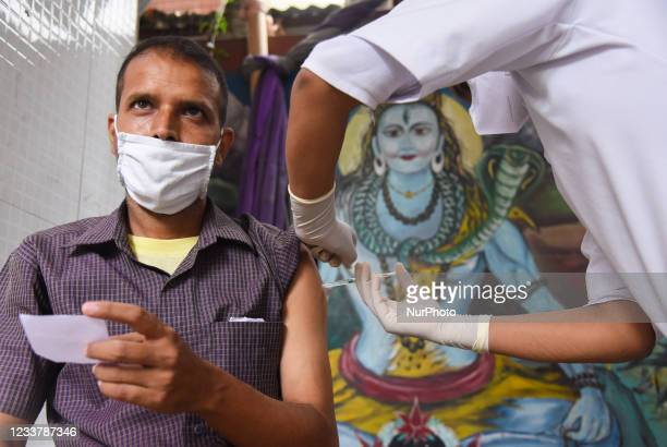 Man receives a dose of COVID-19 coronavirus vaccine at a vaccination centre in Guwahati, Assam, India on Saturday, July 3, 2021.