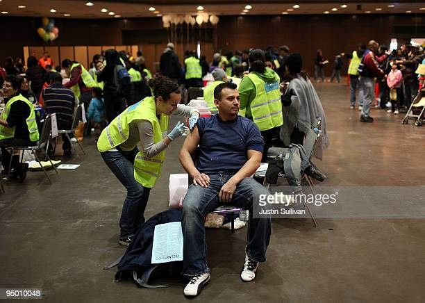 A man receives an H1N1 flu vaccination during a clinic at the Bill Graham Civic Auditorium December 22 2009 in San Francisco California The city had...